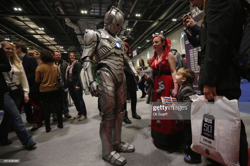 Doctor Who fans meet an actor dressed as a 'Cyberman' at the 'Doctor Who 50th Celebration' event in the ExCeL centre on November 22, 2013 in London, England. The sold-out three day event in the ExCeL London convention centre celebrates 50 years of the show which has seen 11 actors play the role of Doctor Who and receives a worldwide cult following.