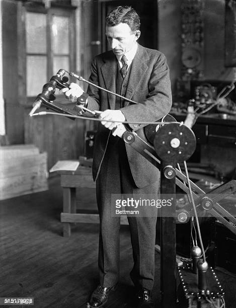 Doctor William David Coolidge adjusts an early version of his XRay tube in a laboratory