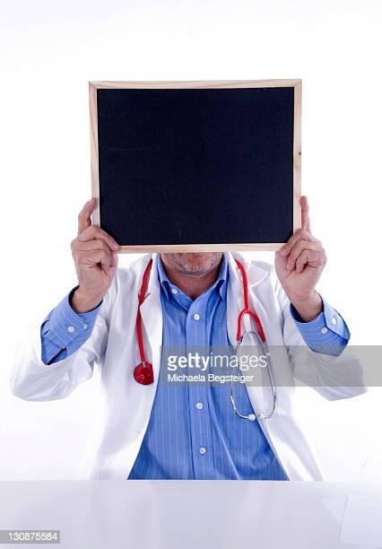 Doctor with a blank blackboard