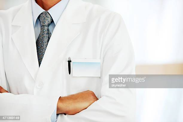 doctor with a blank name tag. - torso stock pictures, royalty-free photos & images