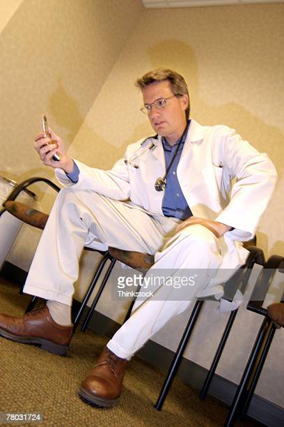 Doctor with cellular phone