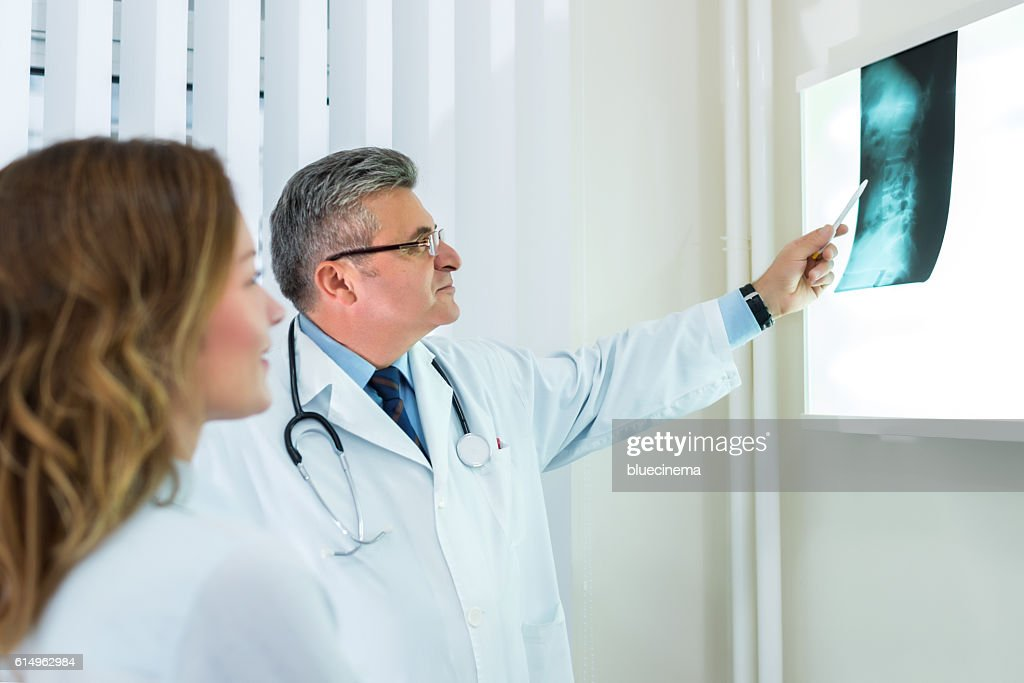 Doctor with female patient : Stock Photo
