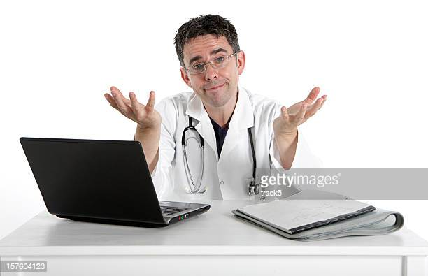 Doctor with laptop and hands raised to show medical problems
