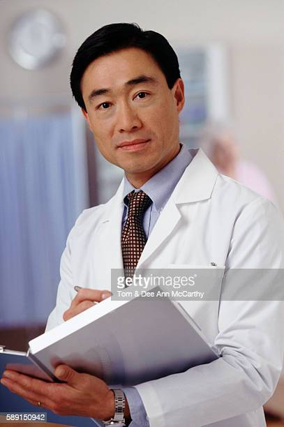 doctor with medical records - dr dee stock pictures, royalty-free photos & images
