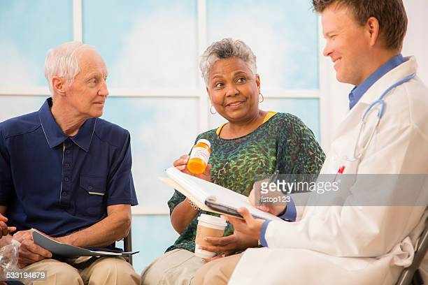 Doctor with patients discussing prescription medication abuse. Therapy.