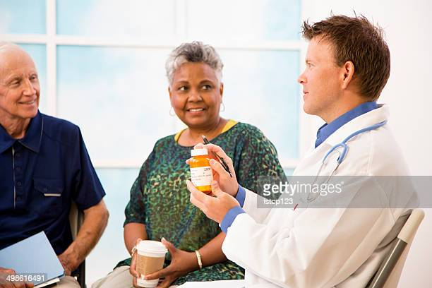 Doctor with patients discussing prescription medication dosage.