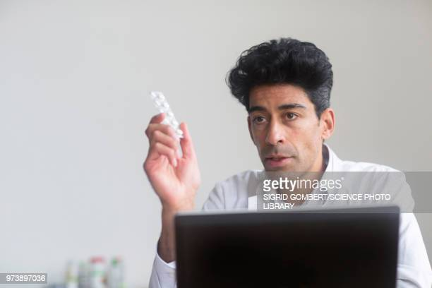 doctor with pills - sigrid gombert stock pictures, royalty-free photos & images