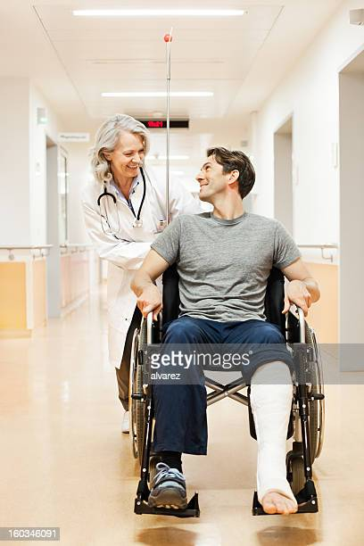 Doctor with recovering patient