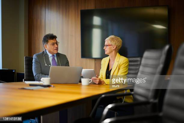 doctor with sales person - lawyer stock pictures, royalty-free photos & images
