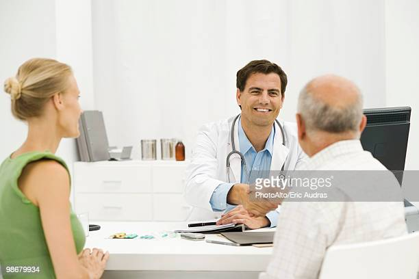 Doctor with senior patient providing medical consultation
