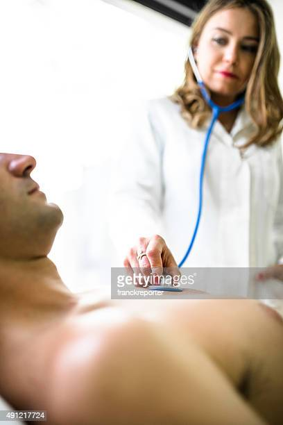Doctor with the stetoscope doing the medical exam