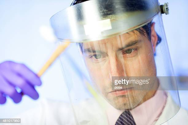 doctor  working at the laboratory examining