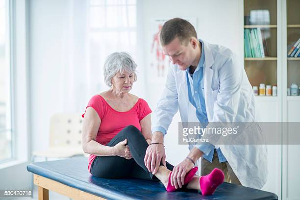 Doctor Working on a Woman's Ankle