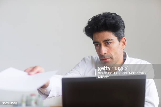 doctor working on laptop - sigrid gombert stock pictures, royalty-free photos & images