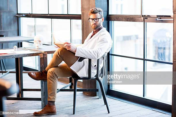 doctor working on medical research - handsome doctors stock pictures, royalty-free photos & images