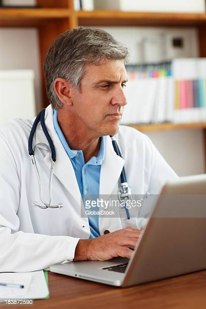 Doctor writing a patient's journal
