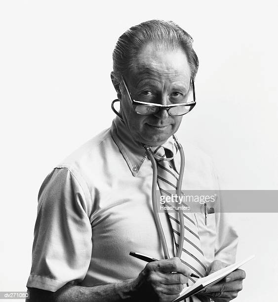 doctor writing a prescription - headhunters stock pictures, royalty-free photos & images