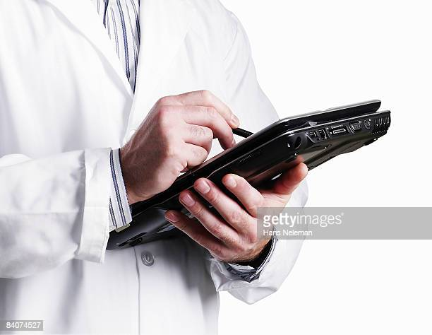 doctor writing in an electronic notepad - scribe stock photos and pictures