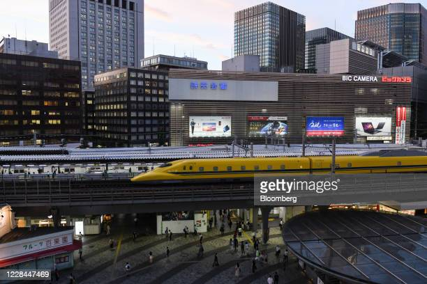 Doctor Yellow' Shinkansen bullet train, a high-speed test train to monitor the condition of tracks and overhead wires, travels along an elevated...