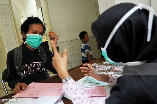 Doctor Yulismar checks the condition of her patient Ilham who has Tuberculosis bacteria at the clinic The Indonesian Association Againt Tuberculosis...