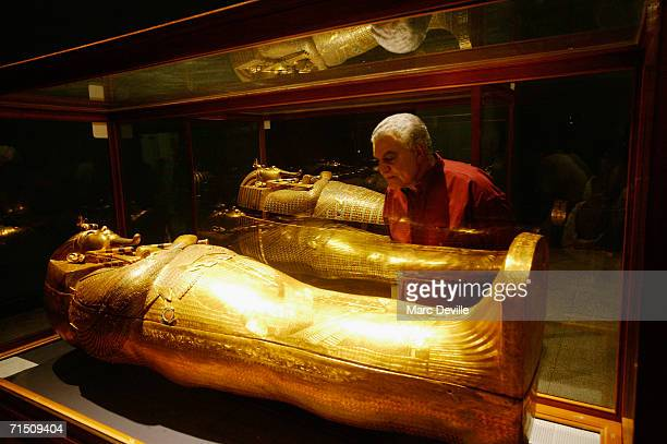 Doctor Zahi Hawass the secretary general of the Supreme Council of Antiquities looks at the sarcophagus of Tutankhamun the most famous Egyptian...