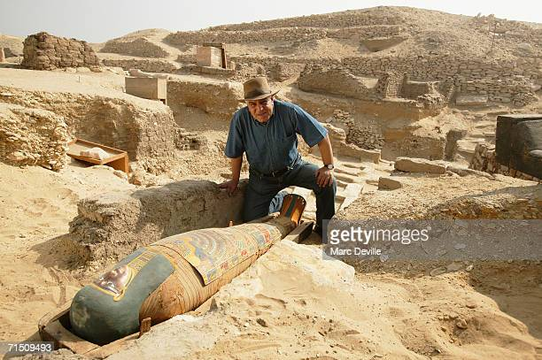 Doctor Zahi Hawass the secretary general of the Supreme Council of Antiquities poses in front of the sarcophagus of a rich merchant in August 2005 in...