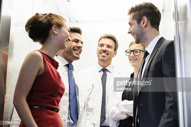 doctors and business people in elevator - five people stock pictures, royalty-free photos & images