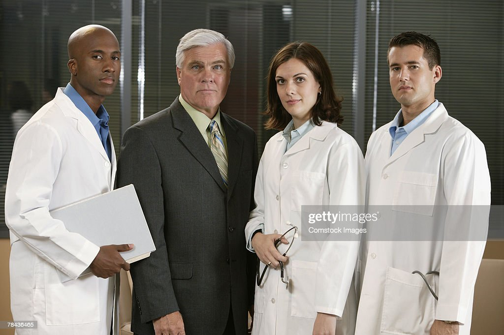Doctors and businessman : Stockfoto