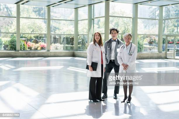 Doctors and businessman standing in empty office