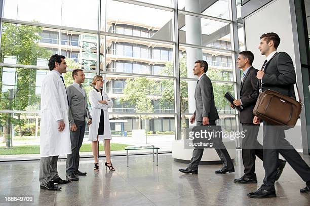 Doctors and businessmen meeting