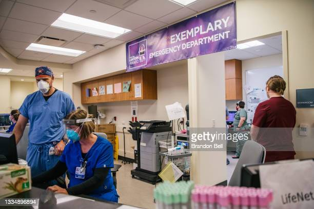 Doctors and Emergency Room nurses are shown working together at the Houston Methodist The Woodlands Hospital on August 18, 2021 in Houston, Texas....