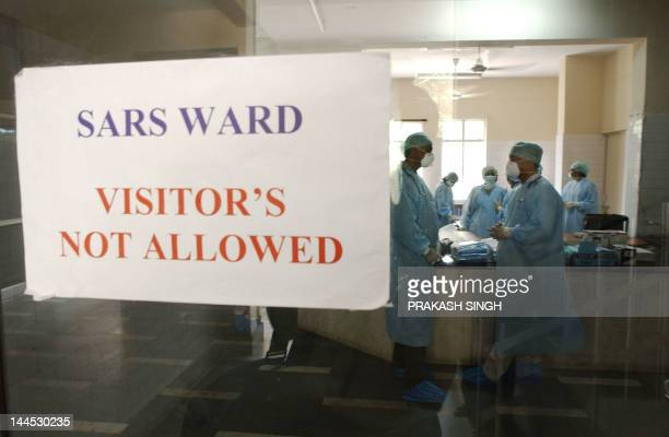 Doctors and hospital staff talk inside the newly built special wards for Severe Acute Respiratory Syndrome patients at the Infectious Disease...