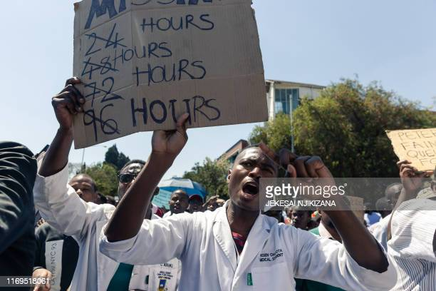 Doctors and medical staff march to Zimbabwe's Parliament on September 19, 2019 in Harare with a petition demanding the safe return of Peter...