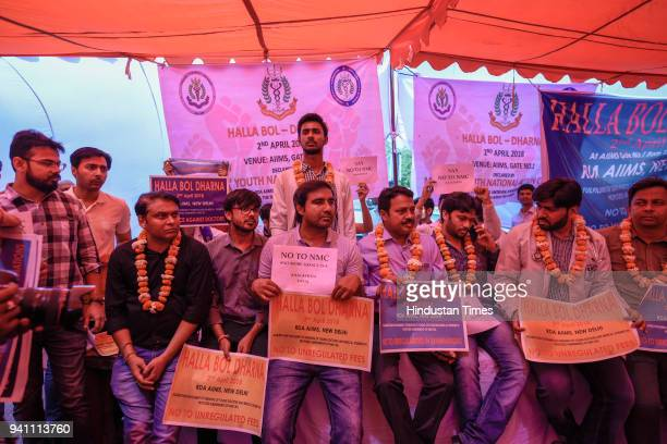 Doctors and medical students during a sitin against the privatization of medical education and hospital care outside All India Institutes of Medical...