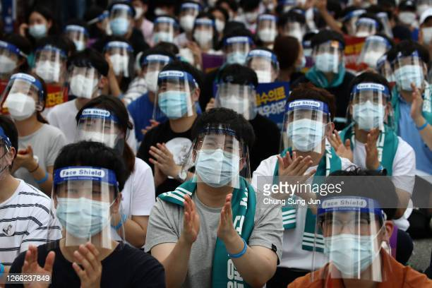 Doctors and medical students wearing face protective equipment as a preventive measure against the coronavirus attend a rally against the government...