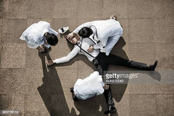 doctors and nurse examining unconscious patient - hot nurse stock photos and pictures