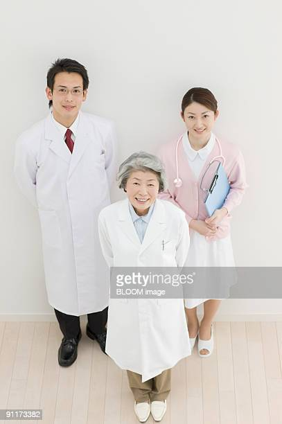Doctors and nurse, portrait, high angle view