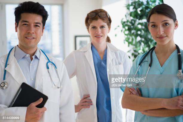 Doctors and nurse smiling in office