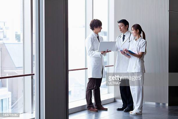 Doctors and nurse talking
