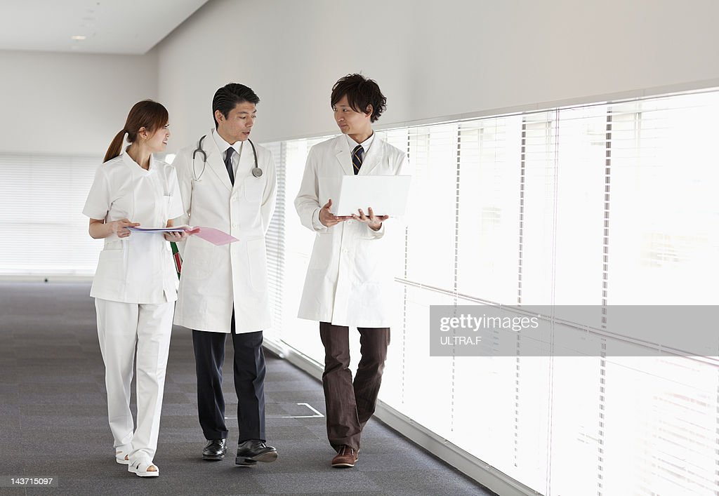 Doctors and nurse talking : Stock Photo