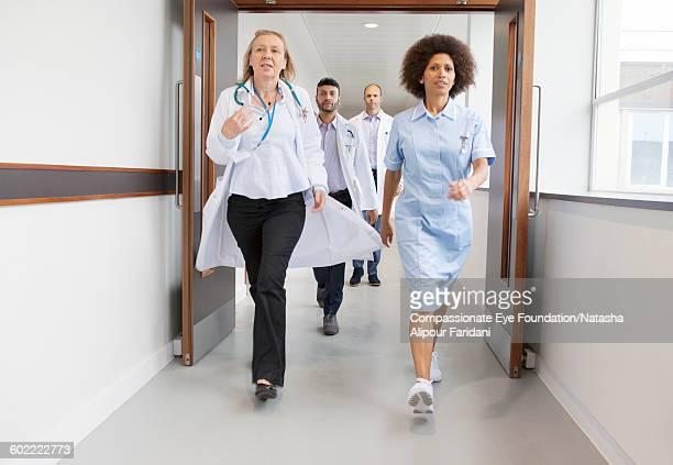 Doctors and nurse walking in hospital corridor