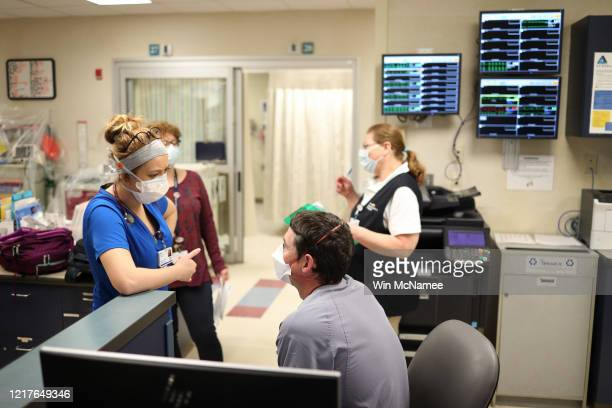 Doctors and nurses confer in the Emergency Department of MedStar St Mary's Hospital April 8 2020 in Leonardtown Maryland MedStar St Mary's Hospital...