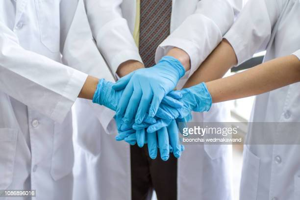 doctors and nurses coordinate hands. concept teamwork in hospital for success work and trust in team - consensus 2018 stock pictures, royalty-free photos & images