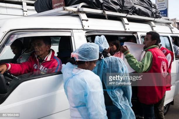 Doctors and nurses from The Ministry of Health and officers of the Malagasy Red Cross staff a healthcare checkpoint at the 'taxibrousse' station of...
