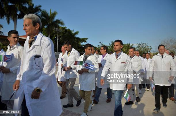 Doctors and nurses of Cuba's Henry Reeve International Medical Brigade are bid farewell before they travel to hardhit Italy to help in the fight...