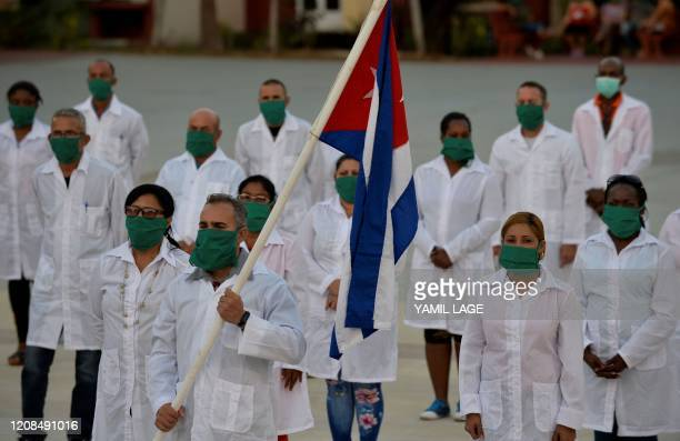 Doctors and nurses of Cuba's Henry Reeve International Medical Brigade take part in a farewell ceremony before traveling to Andorra to help in the...