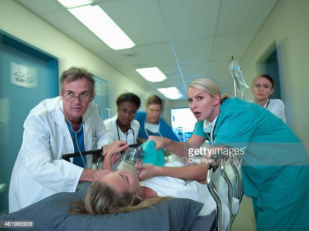 doctors and nurses rushing with patient in hospital - patient on ventilator stock pictures, royalty-free photos & images
