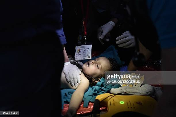 Doctors and paramedics try to revive a child who was later taken to a hospital in a critical condition after a boat with refugees and migrants sunk...