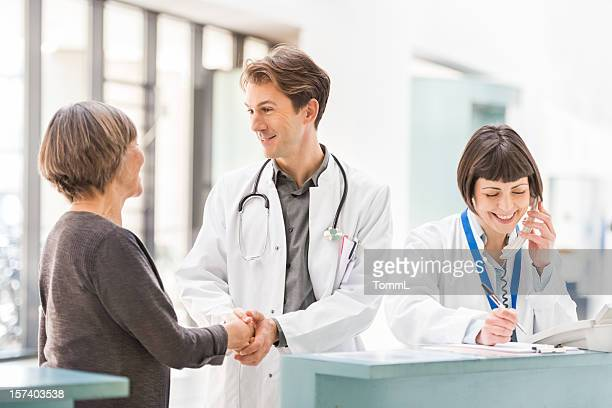 Doctors and Patient at Reception Desk