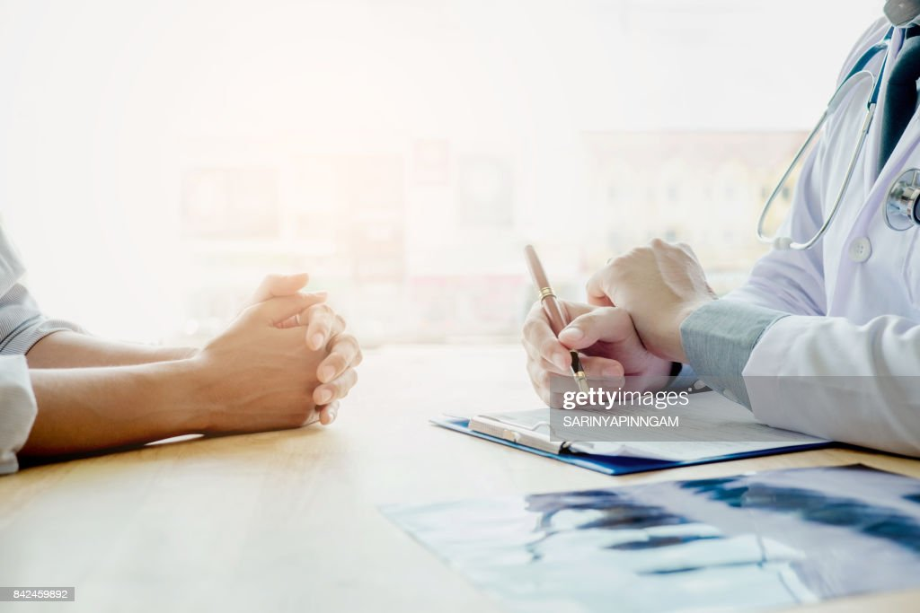 Doctors and patients sit and talk. At the table near the window in the hospital. Doctors and patients sit and talk. At the table near the window in the hospital. : Stock Photo